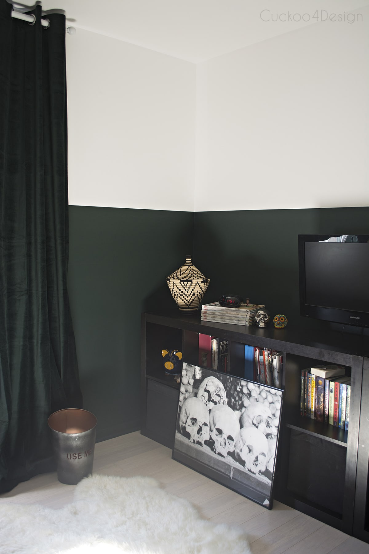 sofisticated boy's soccer room with dark green walls and flags