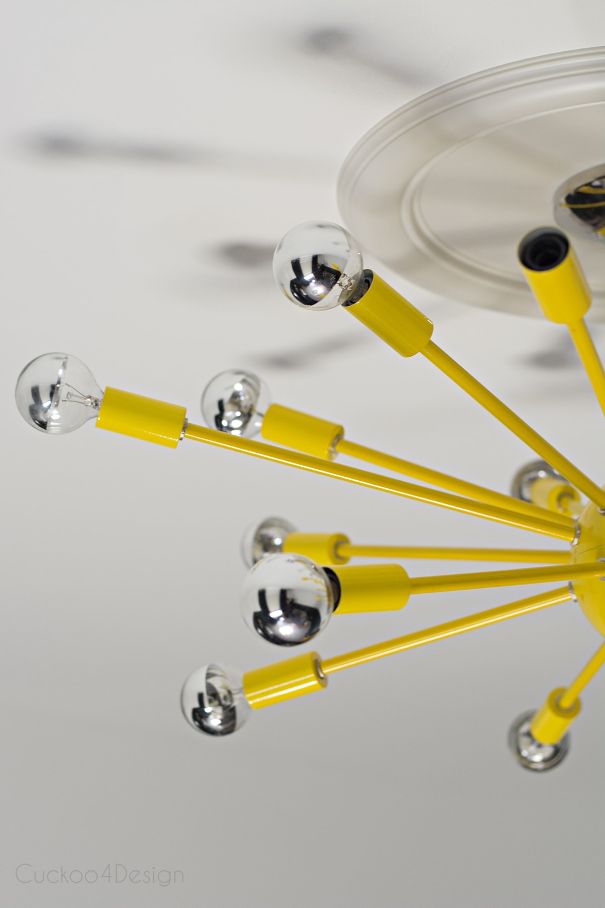 bright yellow sputnik with chrome light bulbs