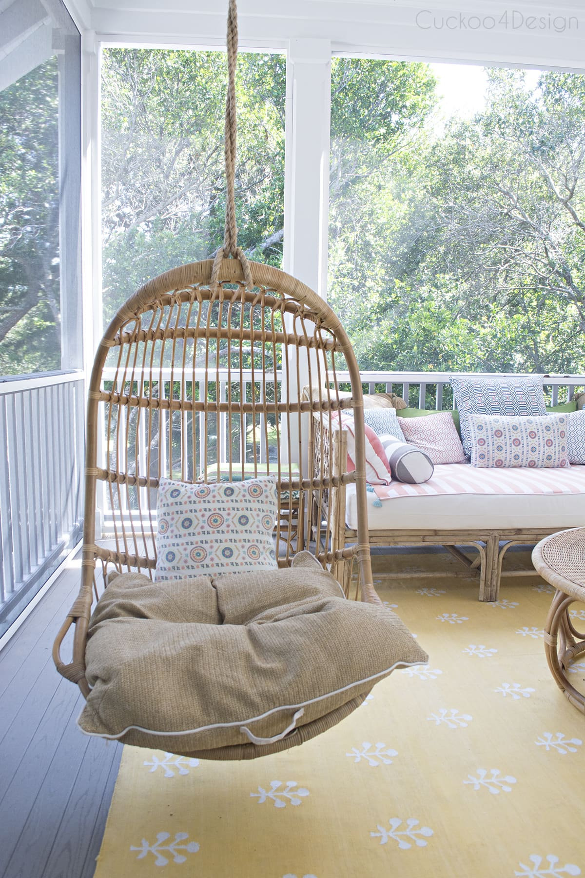 eclectic colorful outdoor deck with rattan wicker and hanging chairs hanging chairs