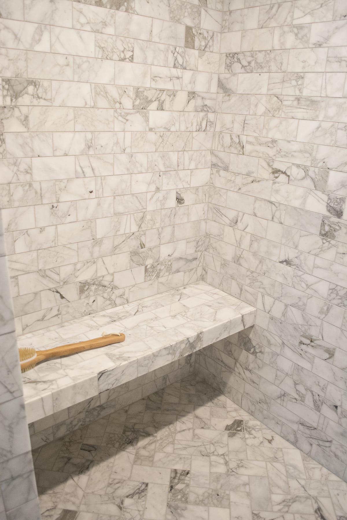 marble bathroom with Delta fixtures