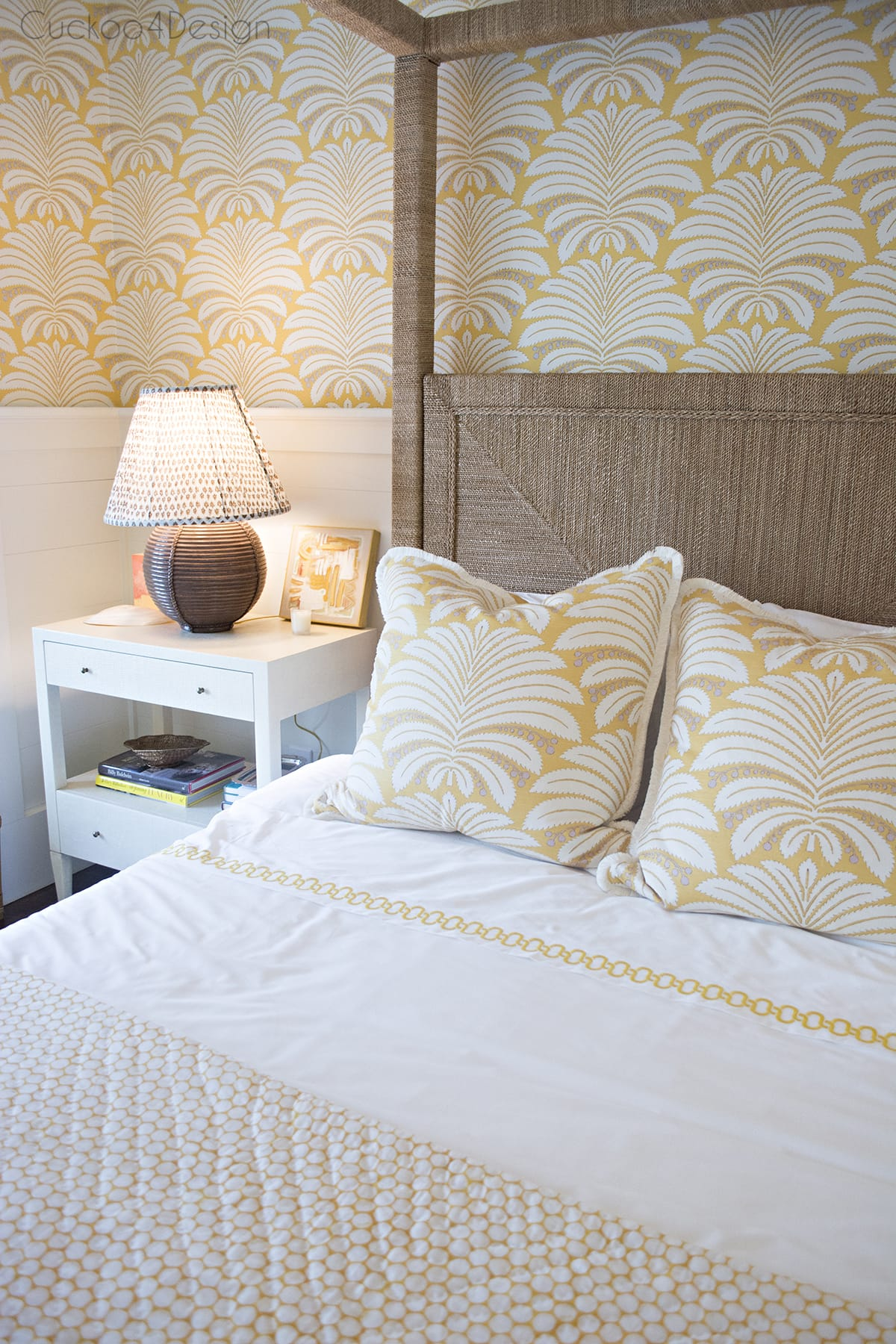 vintage wicker rattan canopy bed in master bedroom with Hines Palmyra in yellow wallpaper and fabric