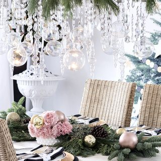 icicles dripping from a chandelier with real pine garland for a festive Christmas dining table