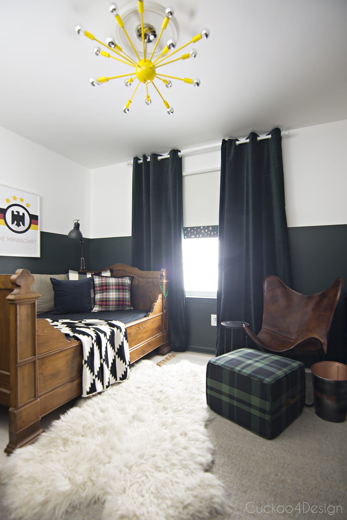 dark green boys bedroom with yellow sputnik