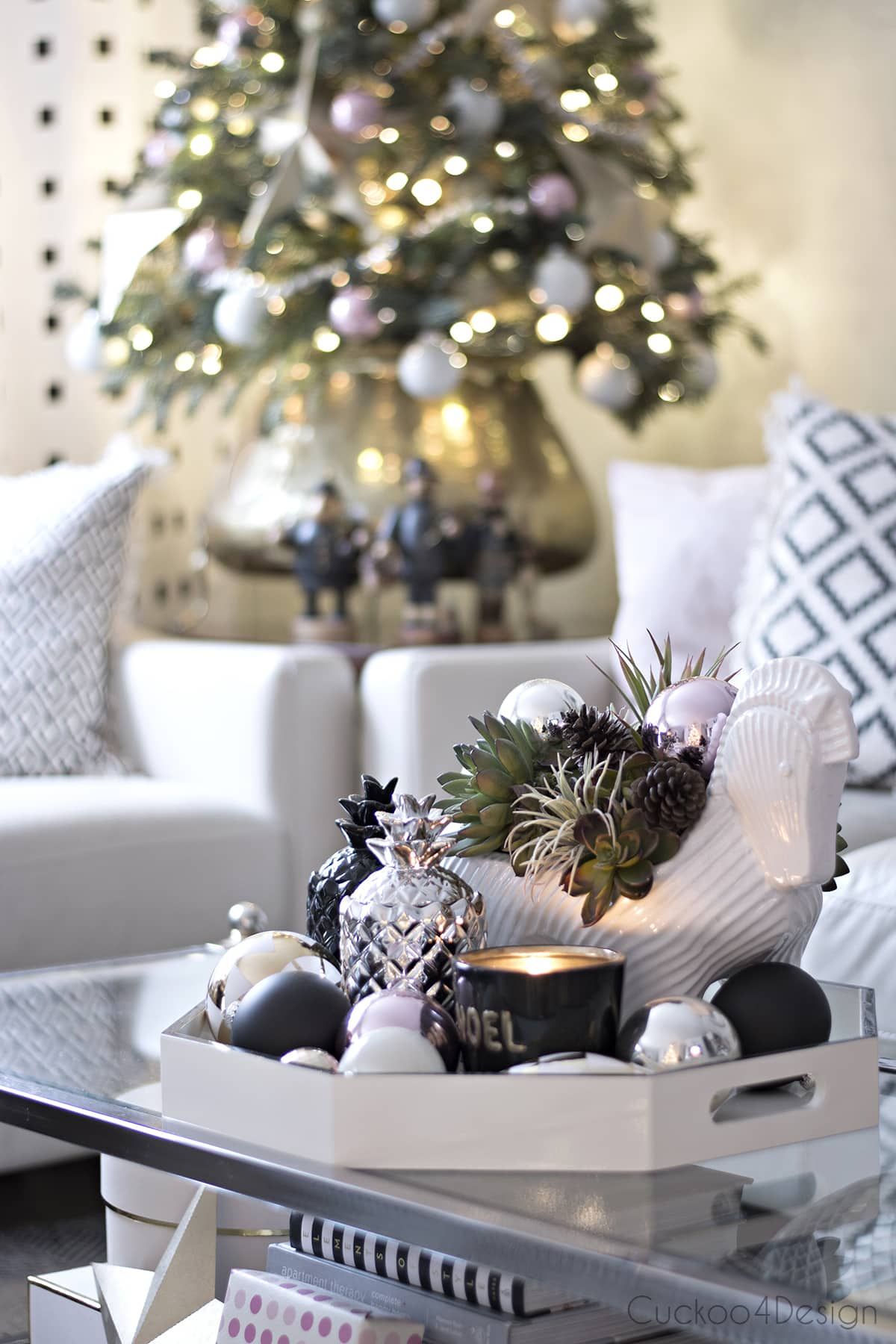 beautiful pineapple candles decorated for Christmas with ceramic horse planter and small Christmas tree in vintage brass pot