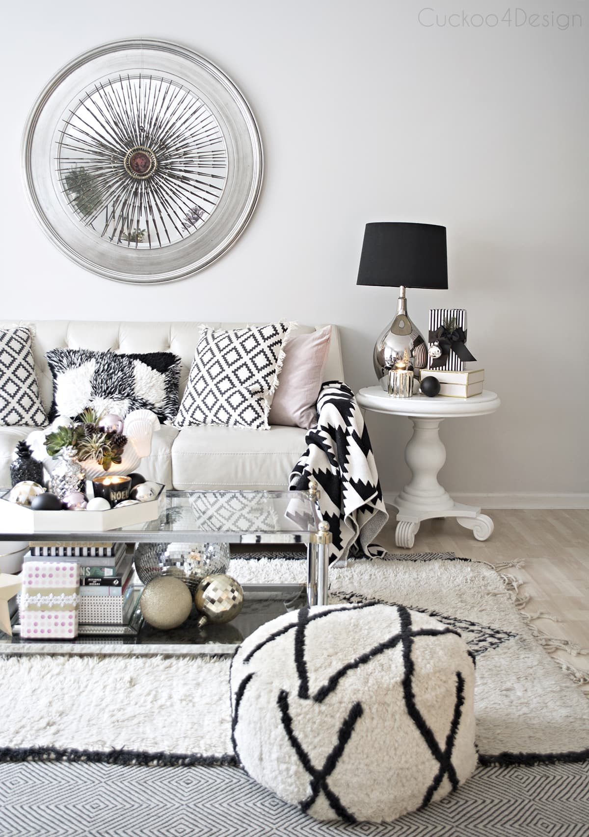 beautiful bohemian eclectic living room with black and white accents, mixed metallics and blush accents | vintage Curtis Jere burst over mirror | Beni Ourrain |