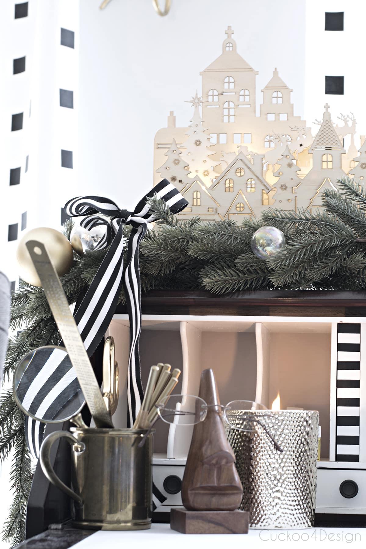 wooden Christmas village on desk