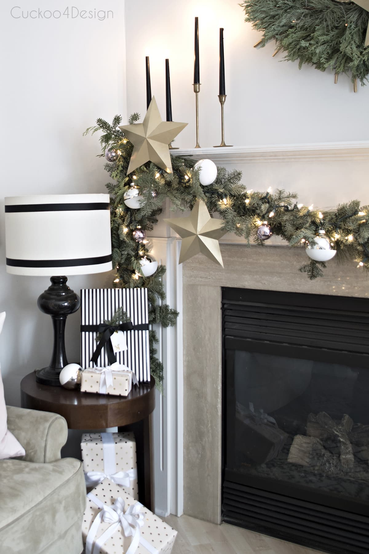 black and white fireplace area with real garland and wreath | pinecone art | cozy shag rugs and blush and metallic accents