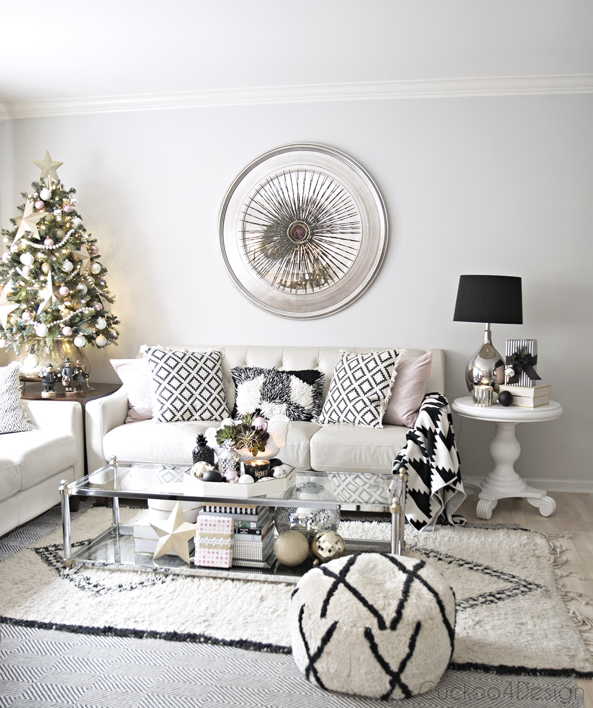 beautiful bohemian eclectic living room with black and white accents, mixed metallics and blush accents | vintage Curtis Jere burst over mirror | Beni Ourrain | small Christmas tree