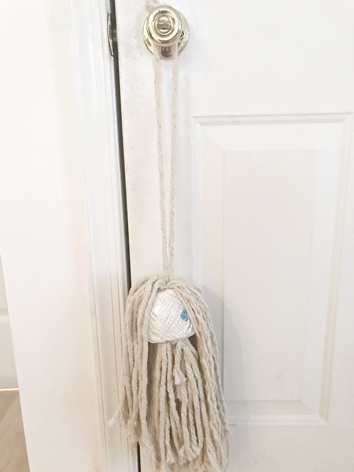 hanging unfinished mop head and twine