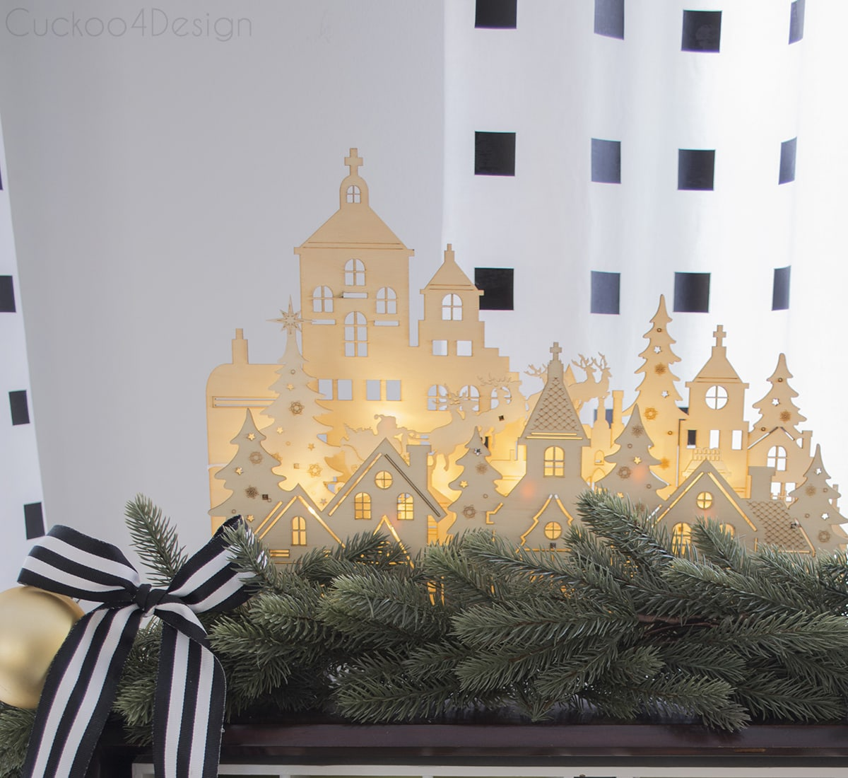 wooden carved little village with lights