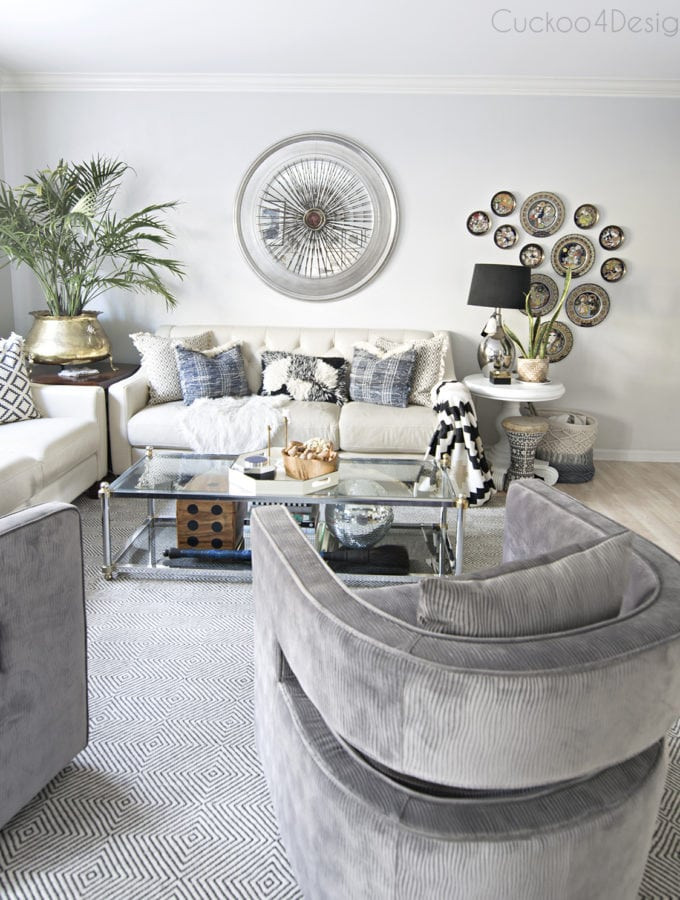 grey velvet swivel chairs in eclectic bohemian living room