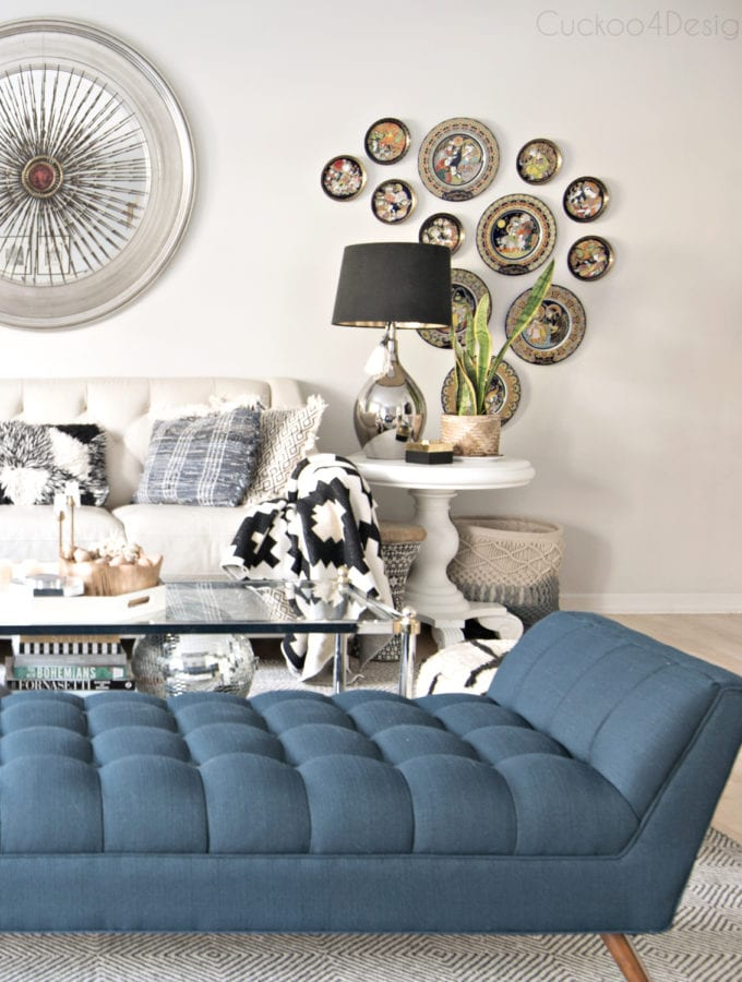 A blue MCM button tufted chaise