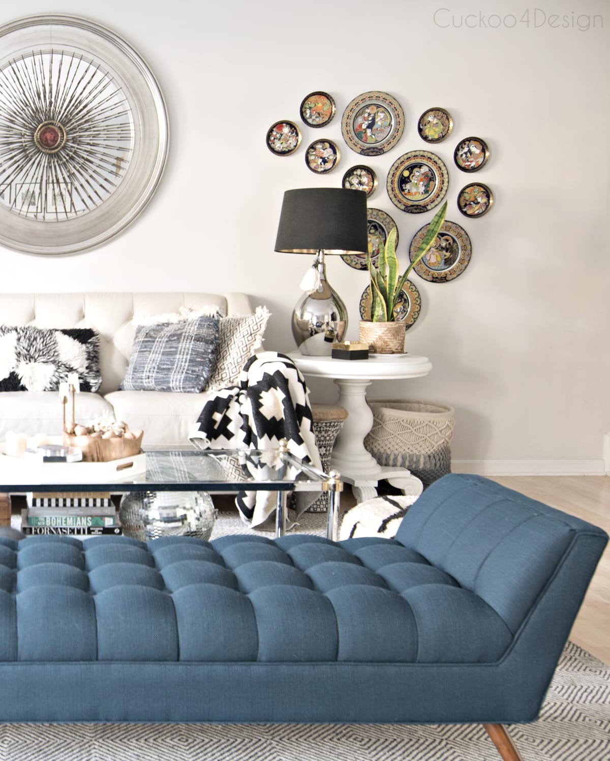 blue button tufted chaise in living room