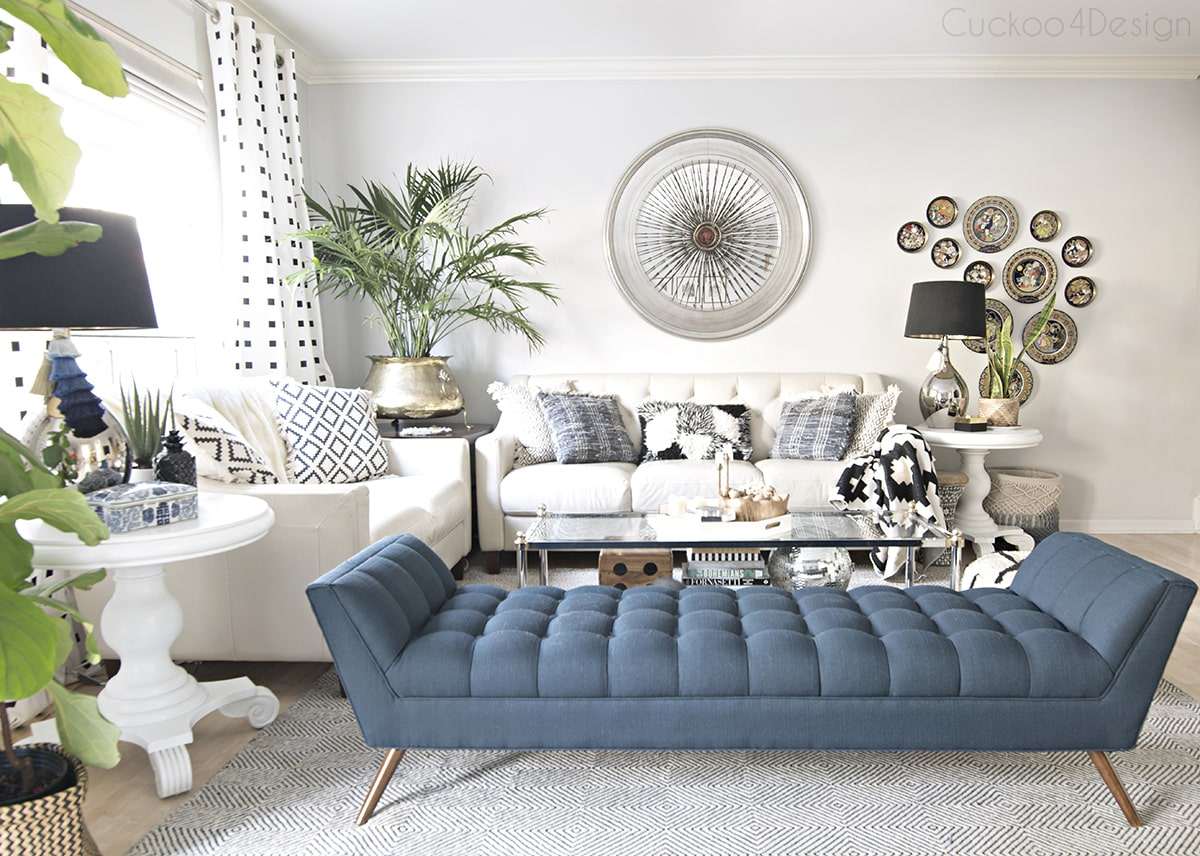 eclectic living room with blue button tufted chaise in living room