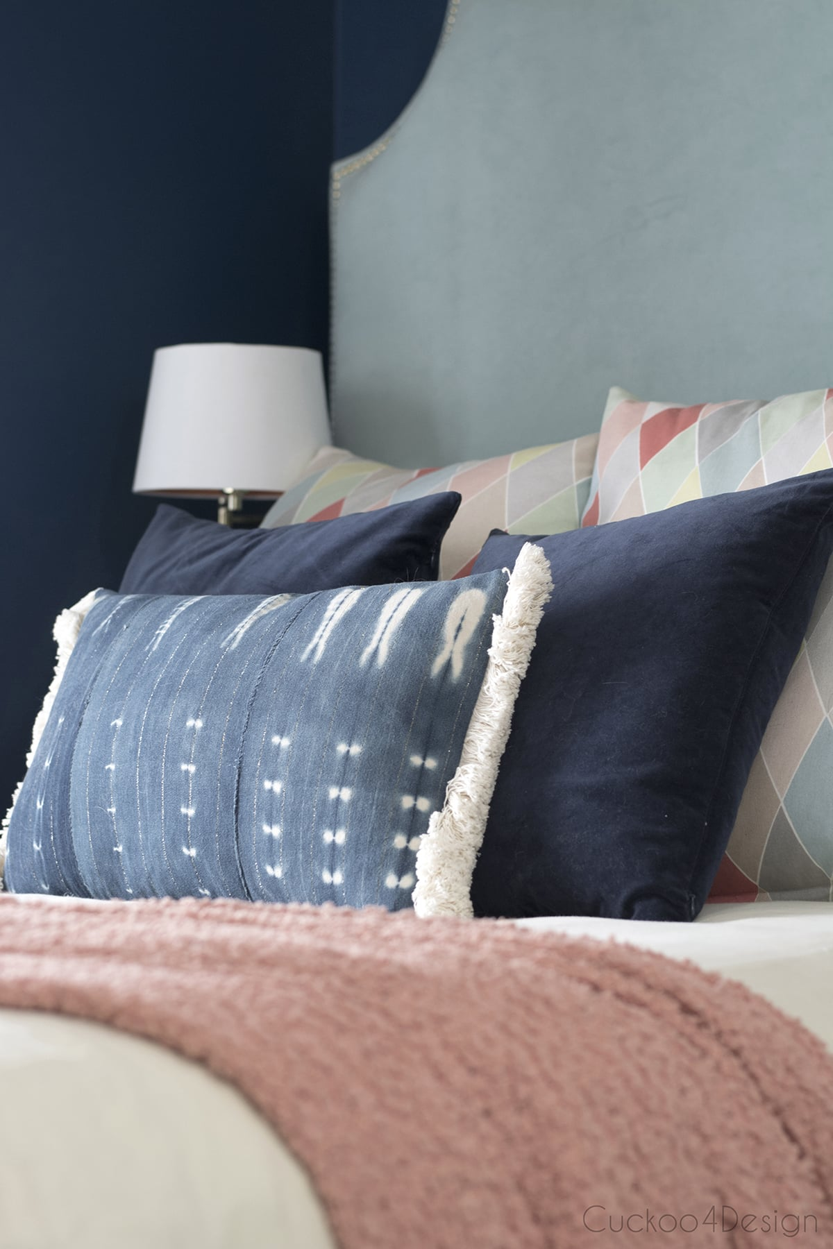 dark blue velvet pillow mixed with mud loth pillow