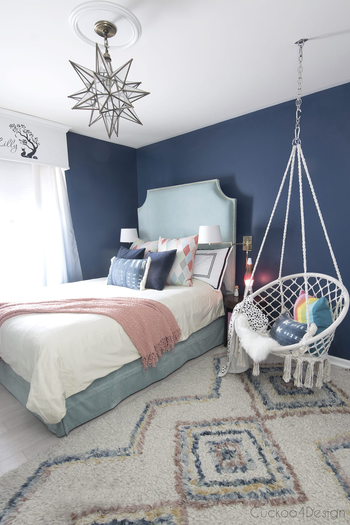 dark blue girls room with turquoise velvet bed and macrame hanging chair