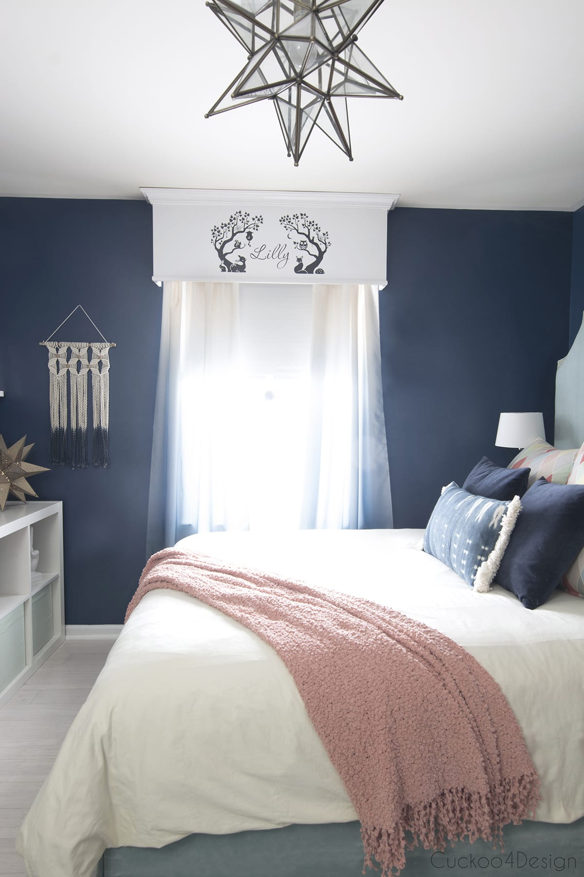 dark blue girls room with ombre curtains and Moravian star pendant