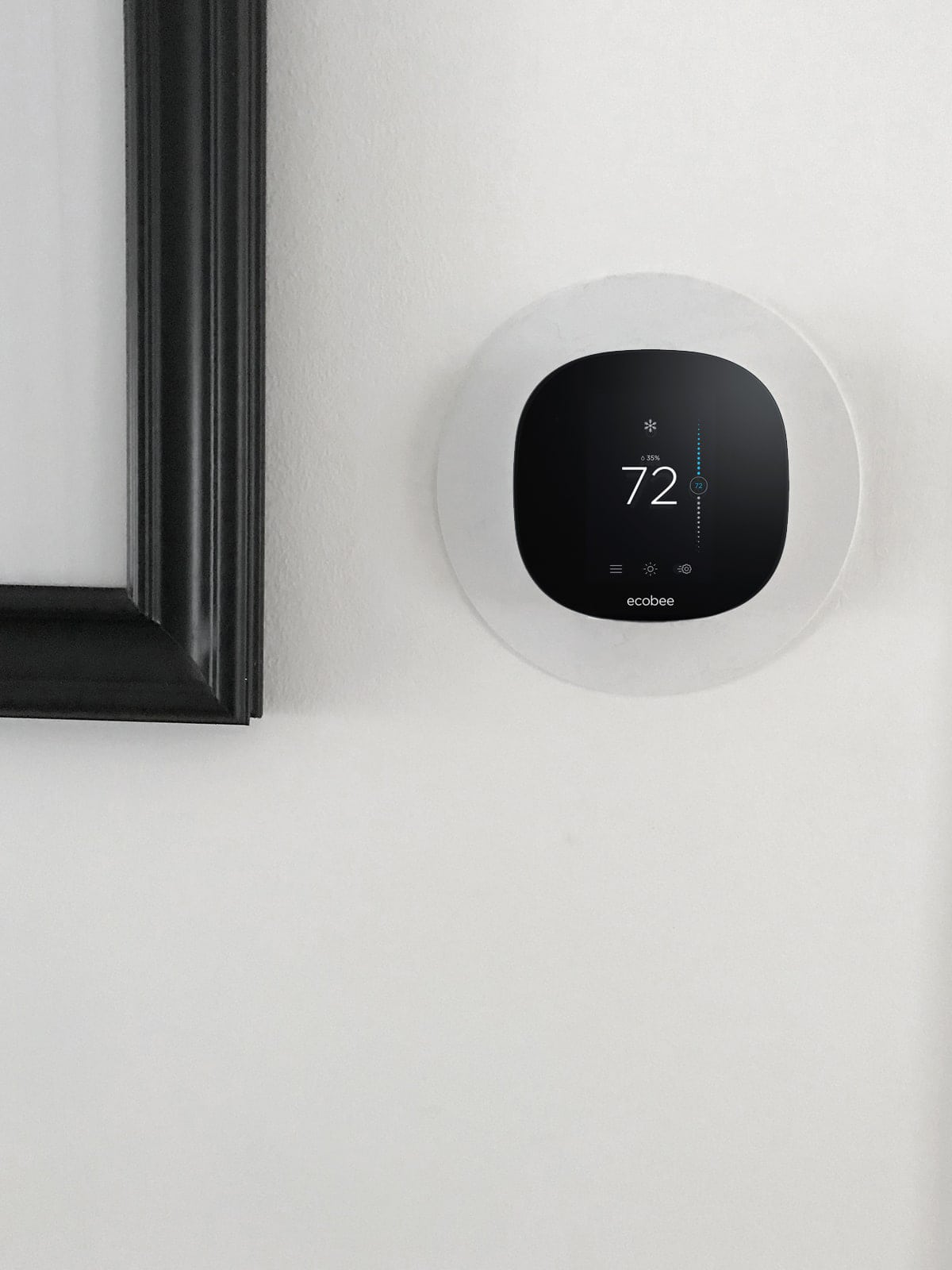 ecobee3 lite hanging on the wall in black and white home