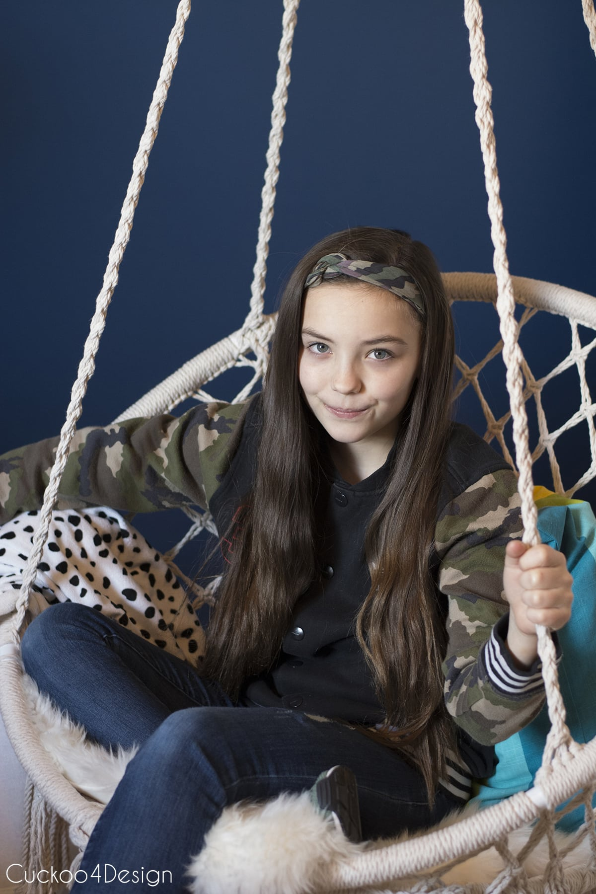 pre-teen sitting in her affordable macrame hanging chair