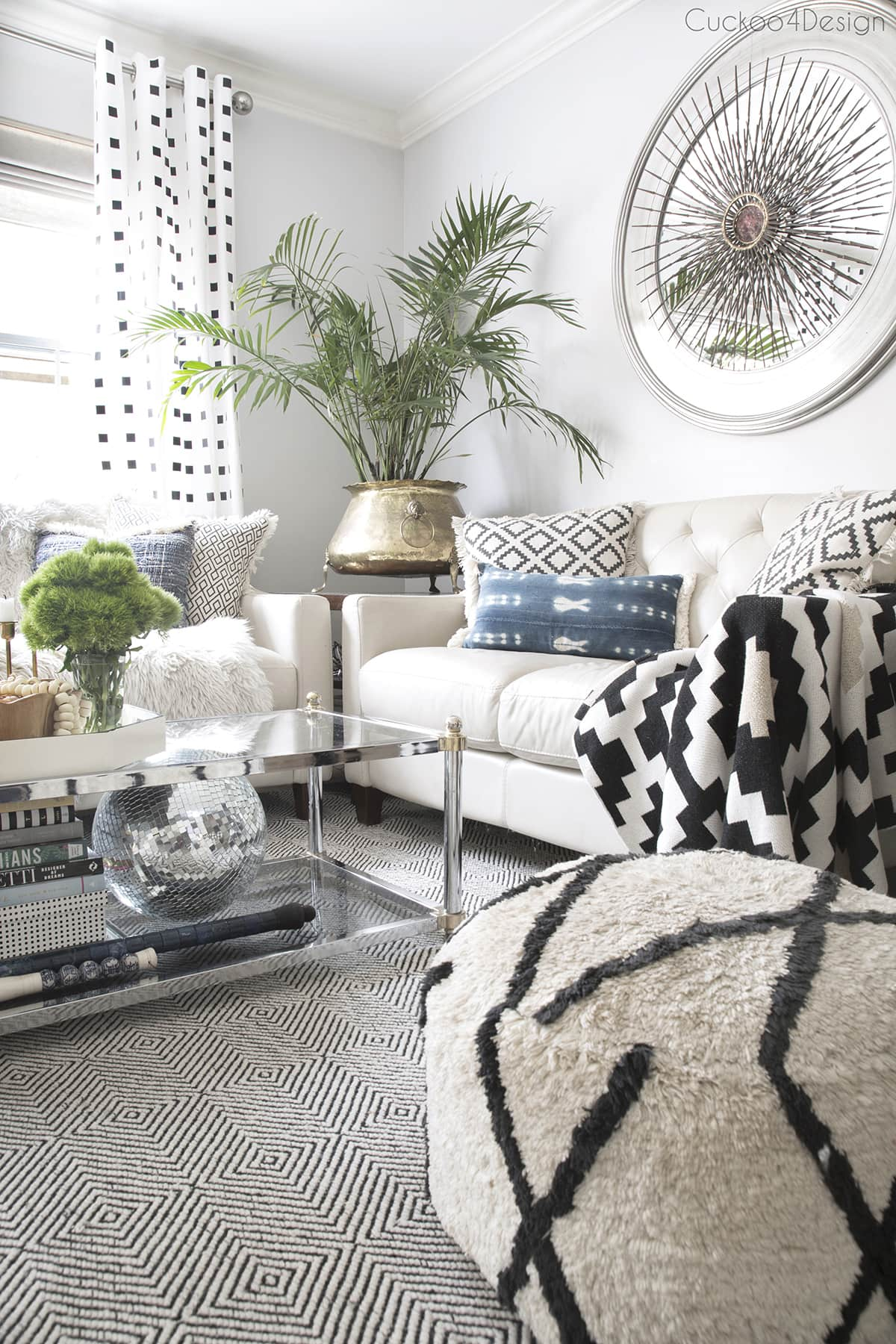 neutral eclectic living room with black and white accents