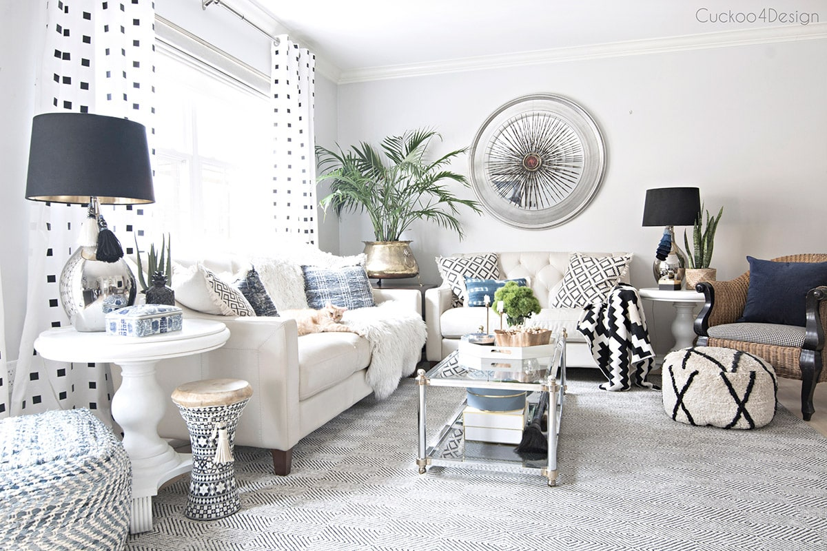 living room with a lot of black and white accents and a bohemian touch