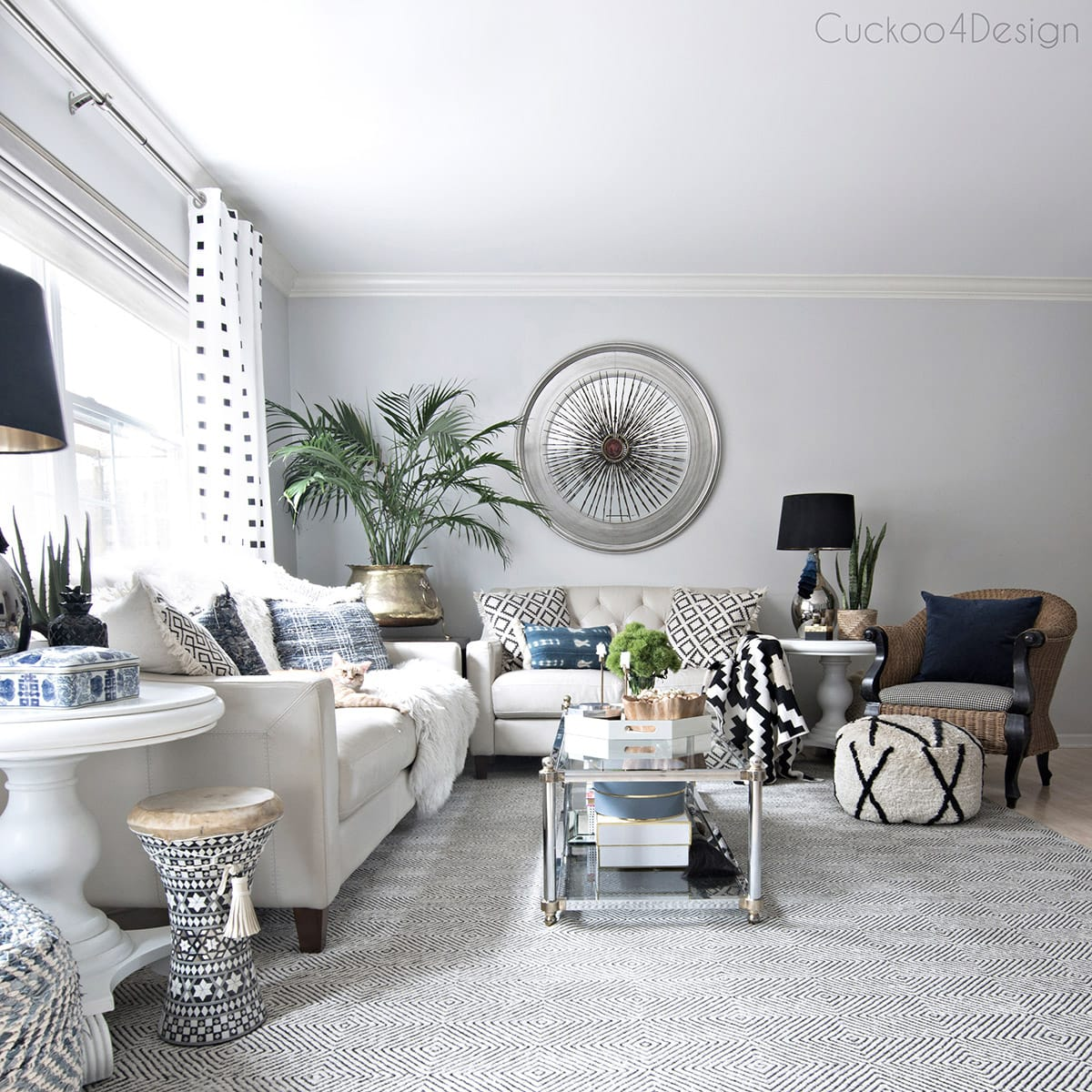 neutral base living room with layered black and white accents and a hint of blue