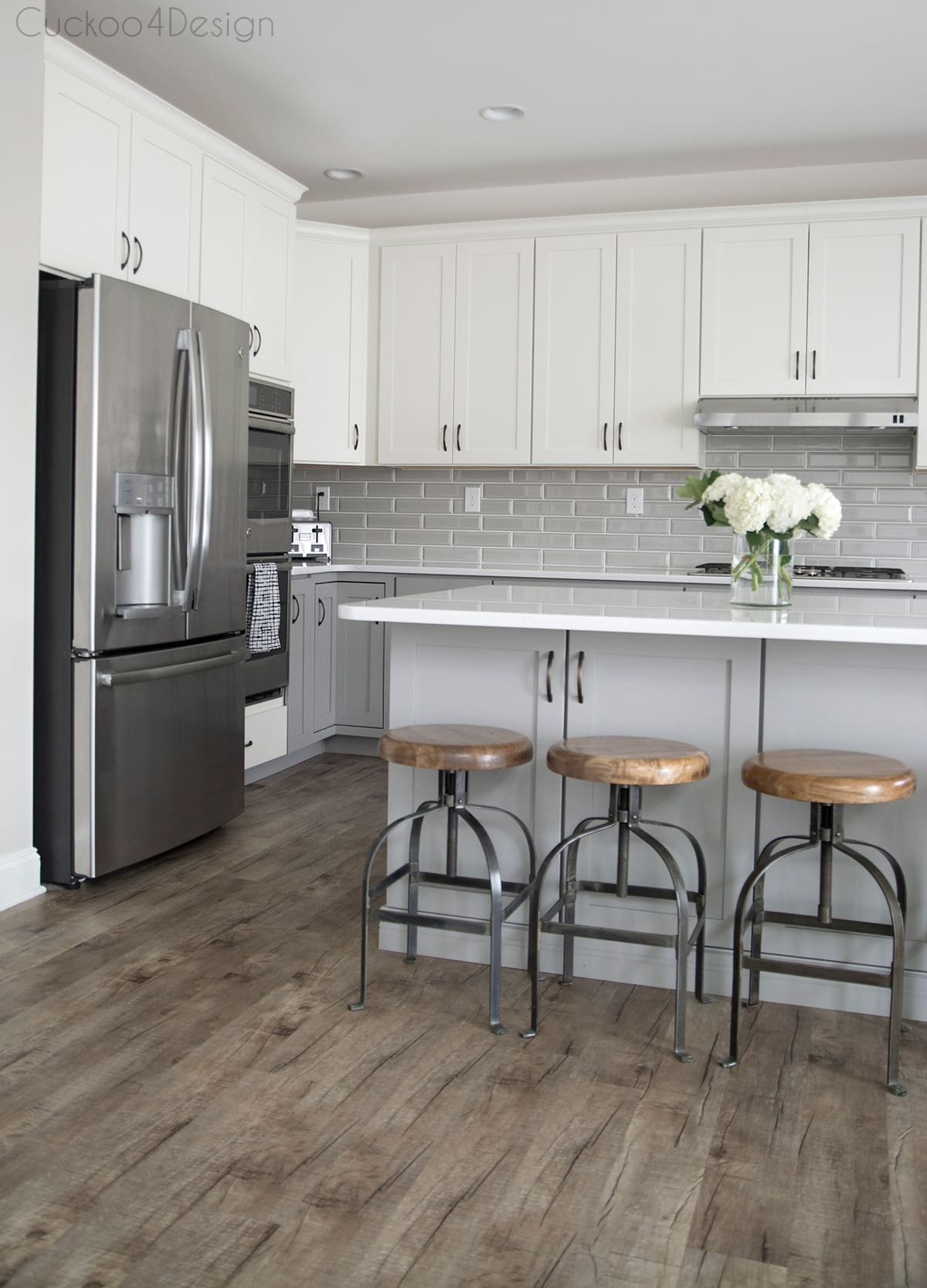glossy grey subway tiles in large white and grey kitchen