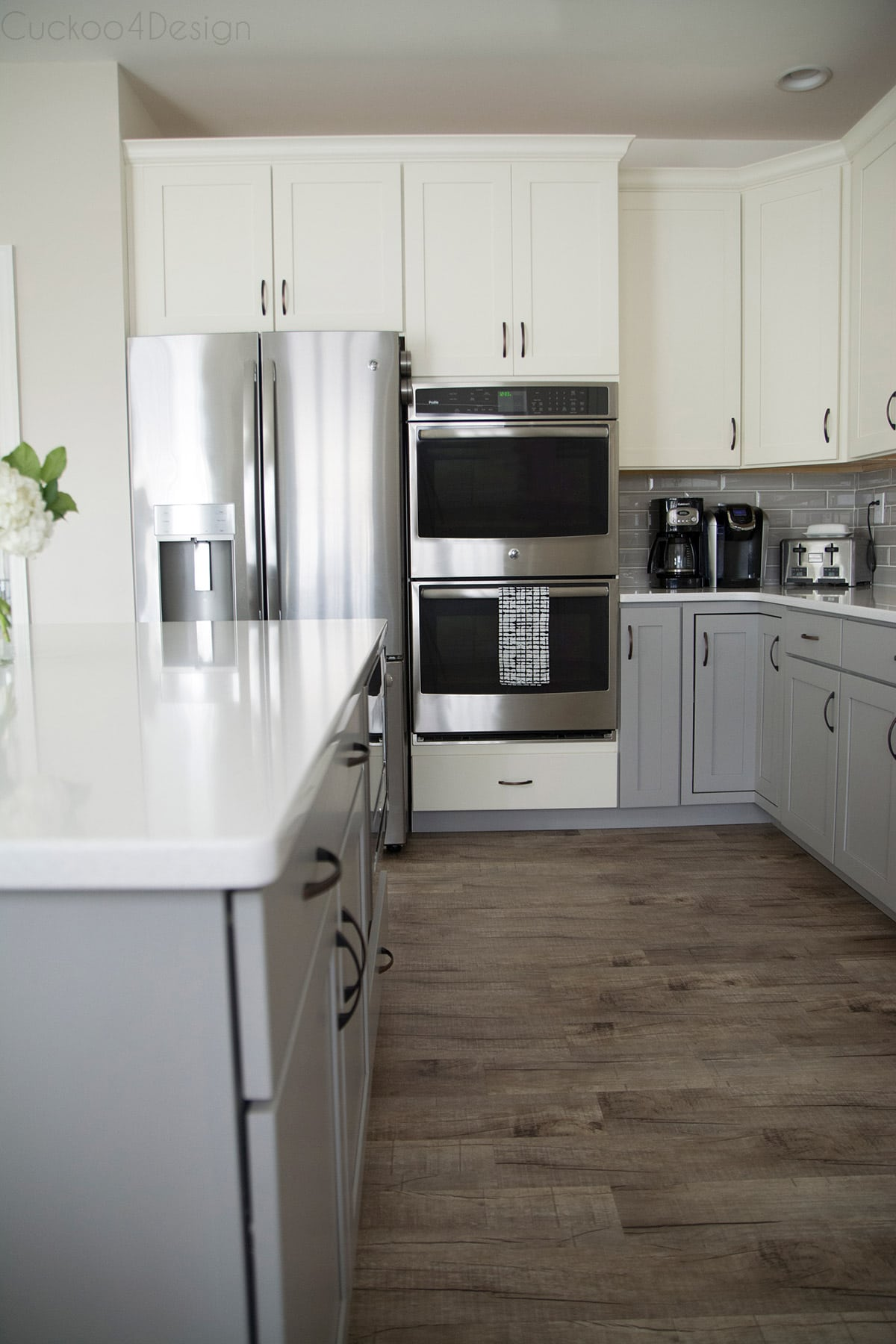 GE stainless steel kitchen appliances in white and grey kitchen