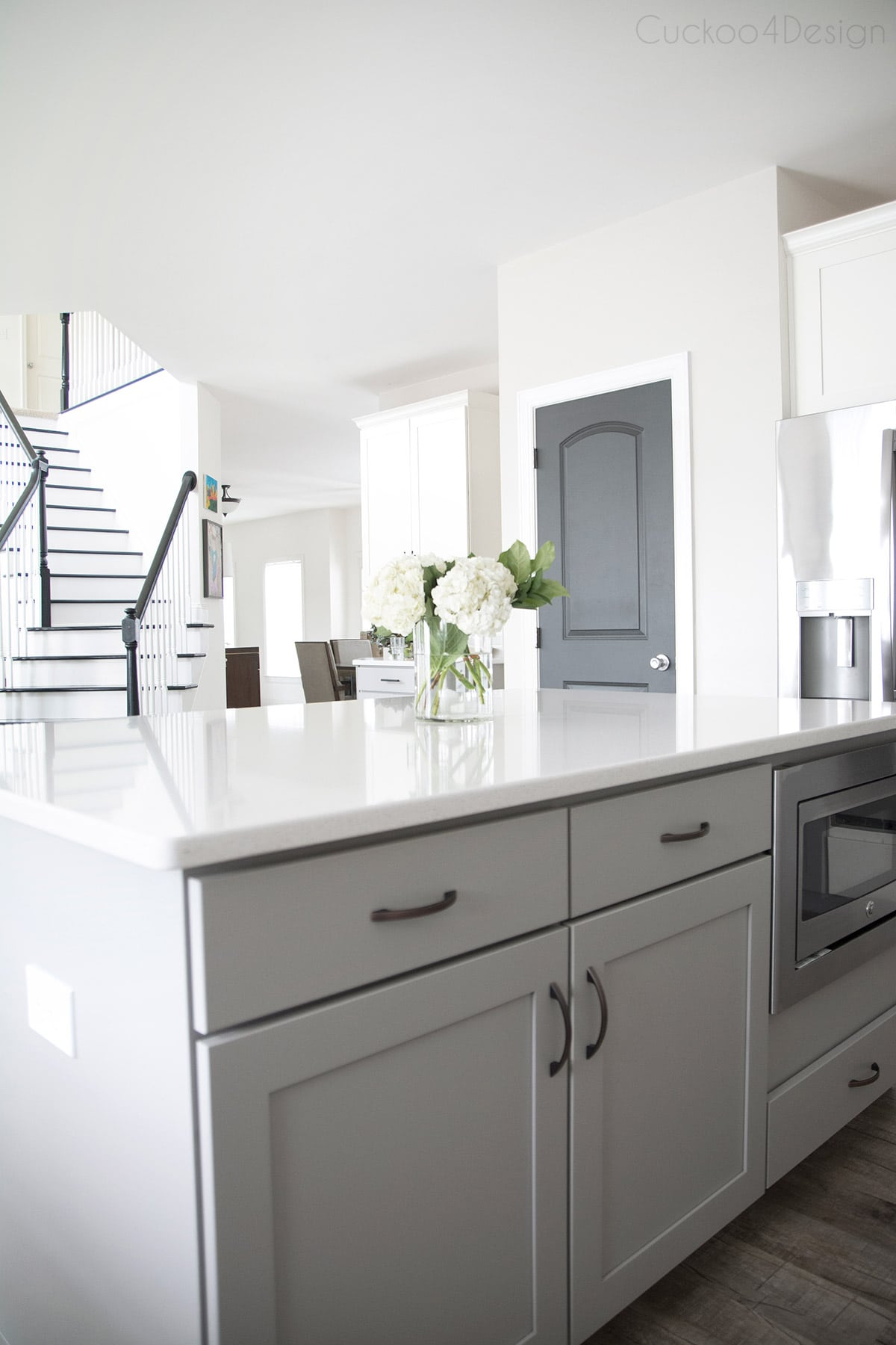 dark grey interior doors in gray and white kitchen with black and white staircase