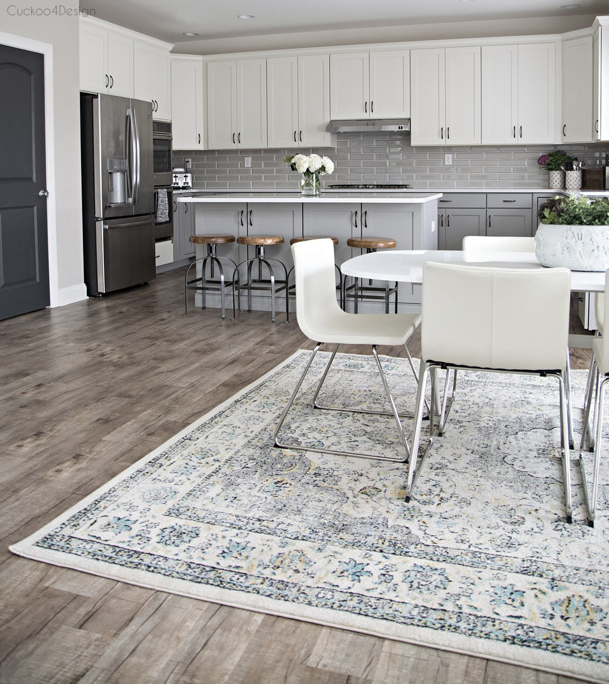 subtle tones of grey, blue, white and cream in kitchen dining room area