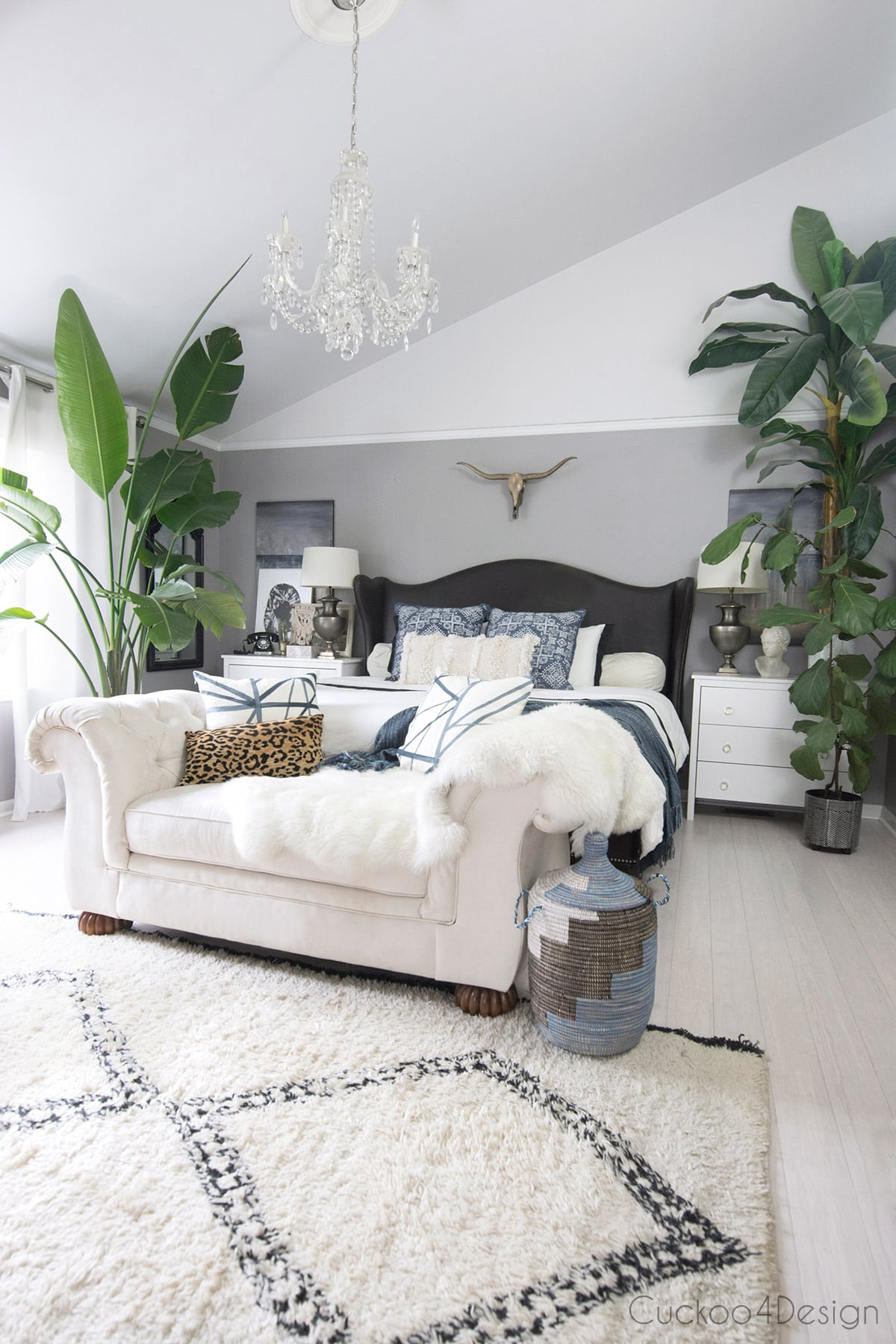blue, ivory and gray bedroom with lots of plants