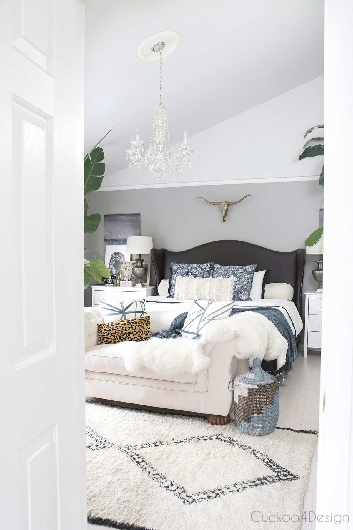eclectic mixed bedroom with neutral decor which was decorated on a budget