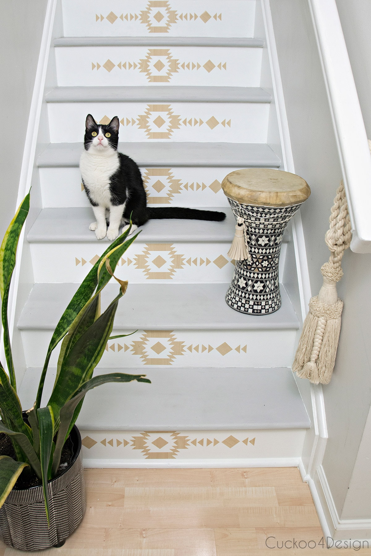 finished staircase makeover with self-adhesive vinyl stair riser decals