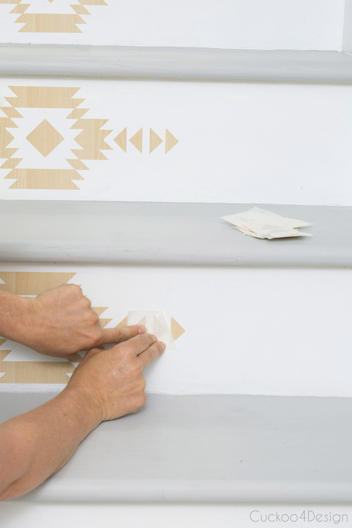 peeling off self-adhesive vinyl stair riser decals
