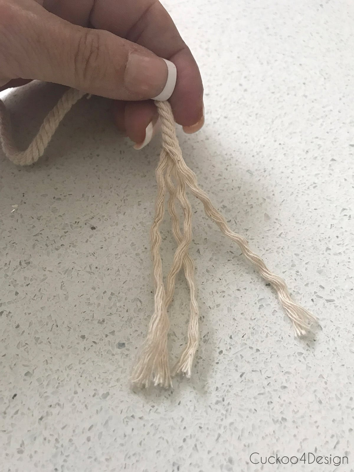 taking yarn apart for macrame earrings