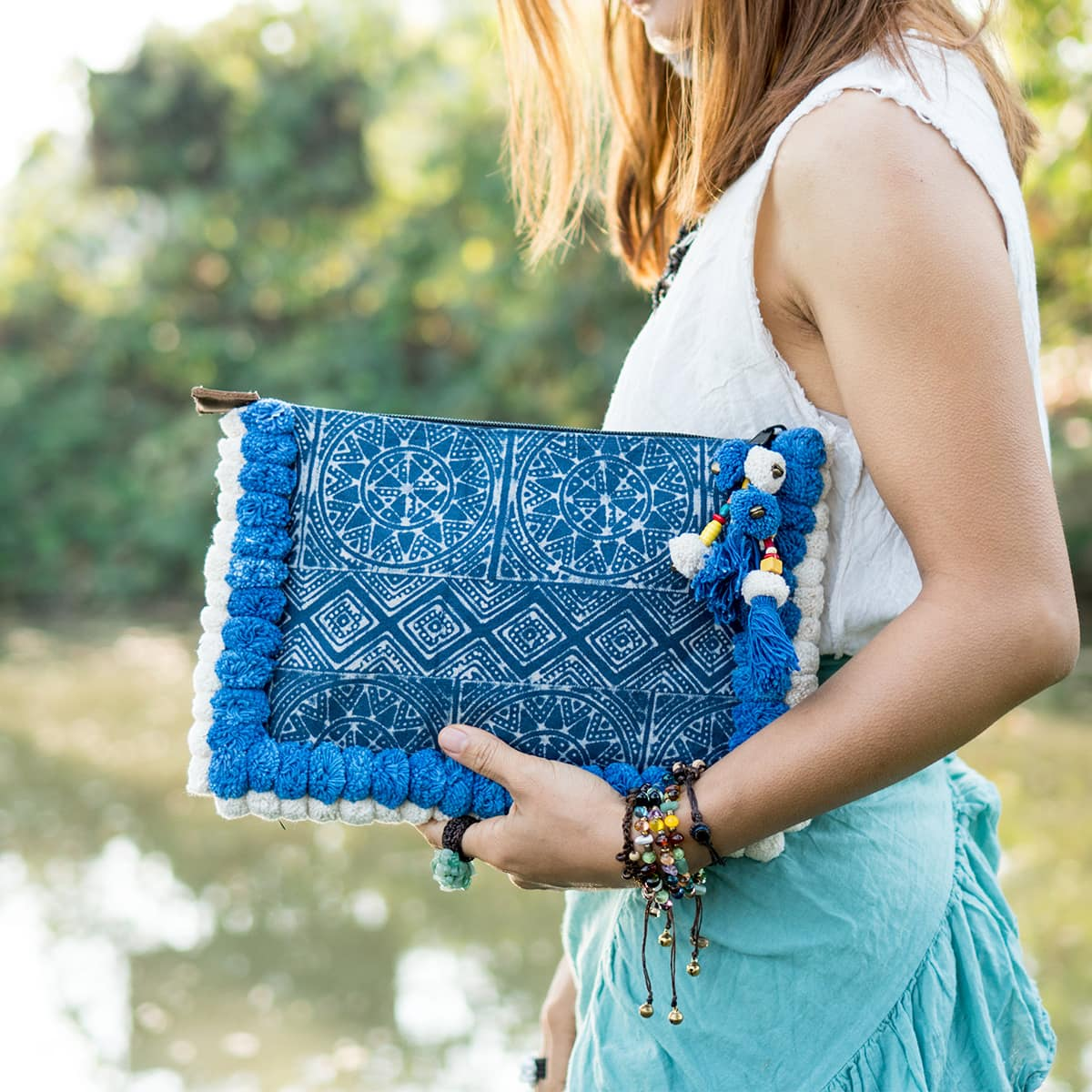 blue and white pom pom clutch