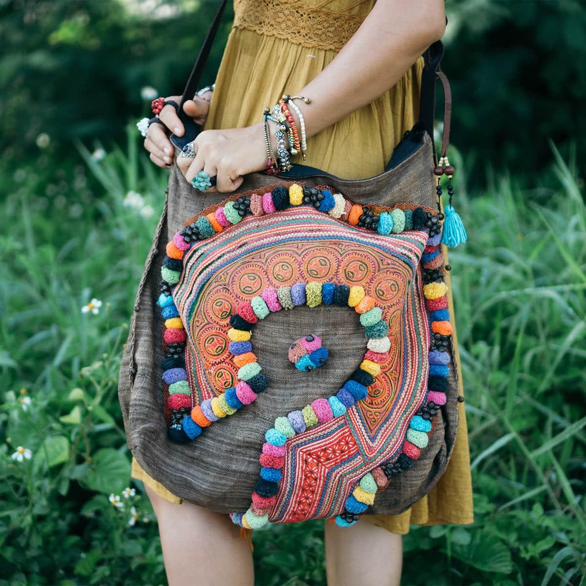 handcrafted pom pom crossbody bag