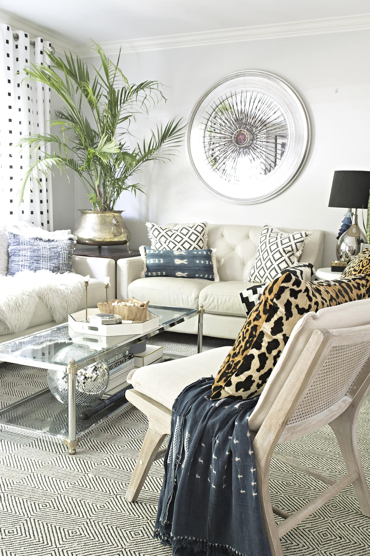 beach bohemian vibes in neutral living room with leopard, black and white and indigo accents