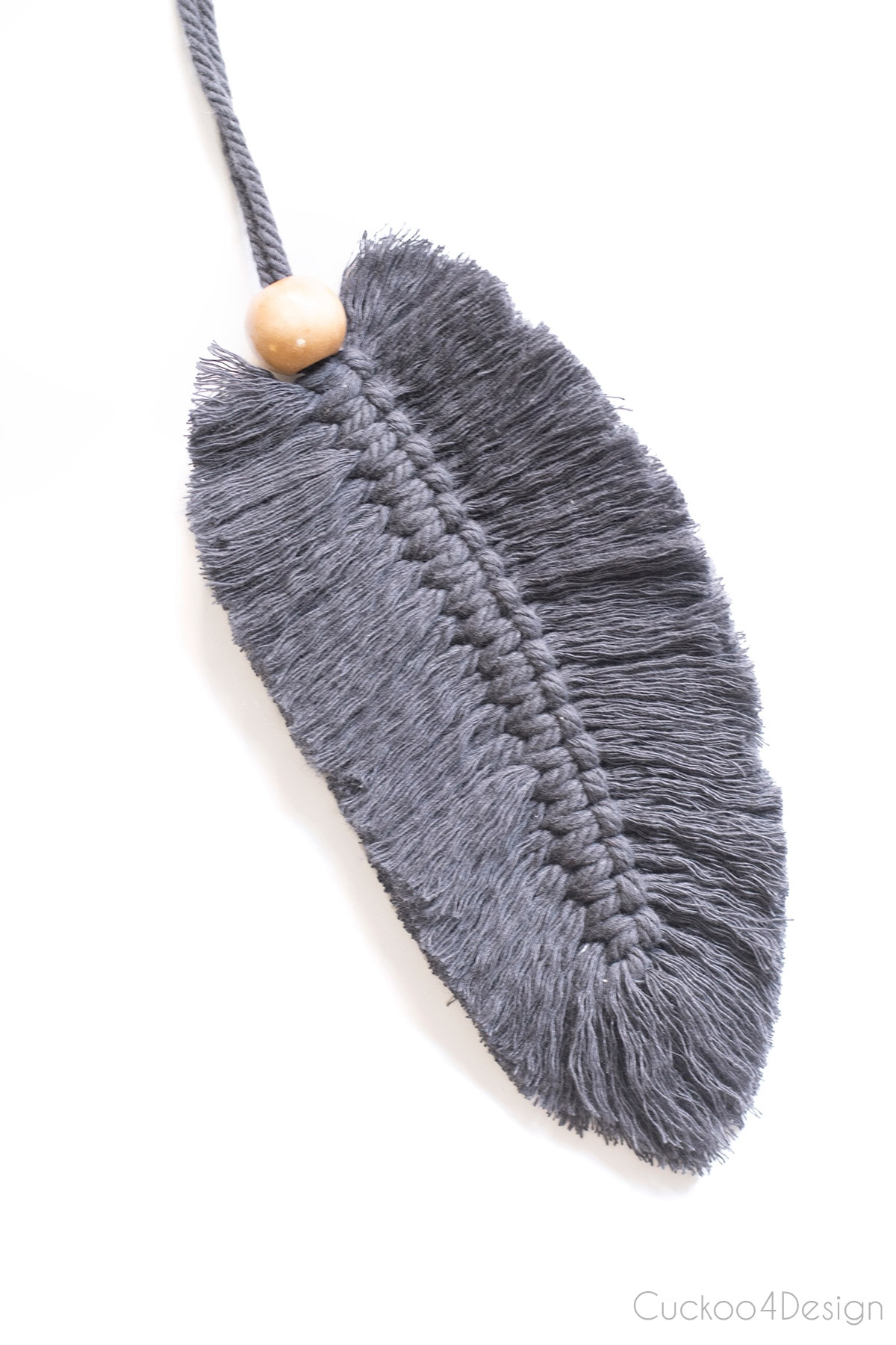 dark gray macrame feather with wood bead detail