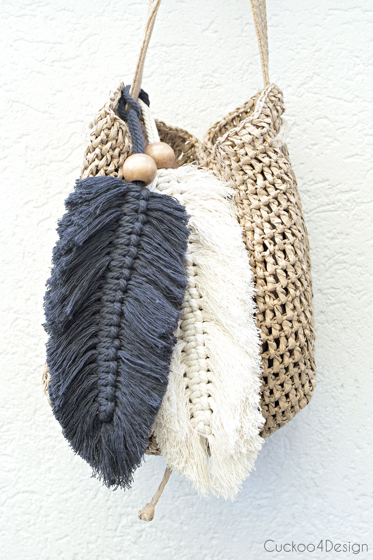 straw bag with large beaded macrame feather purse charms