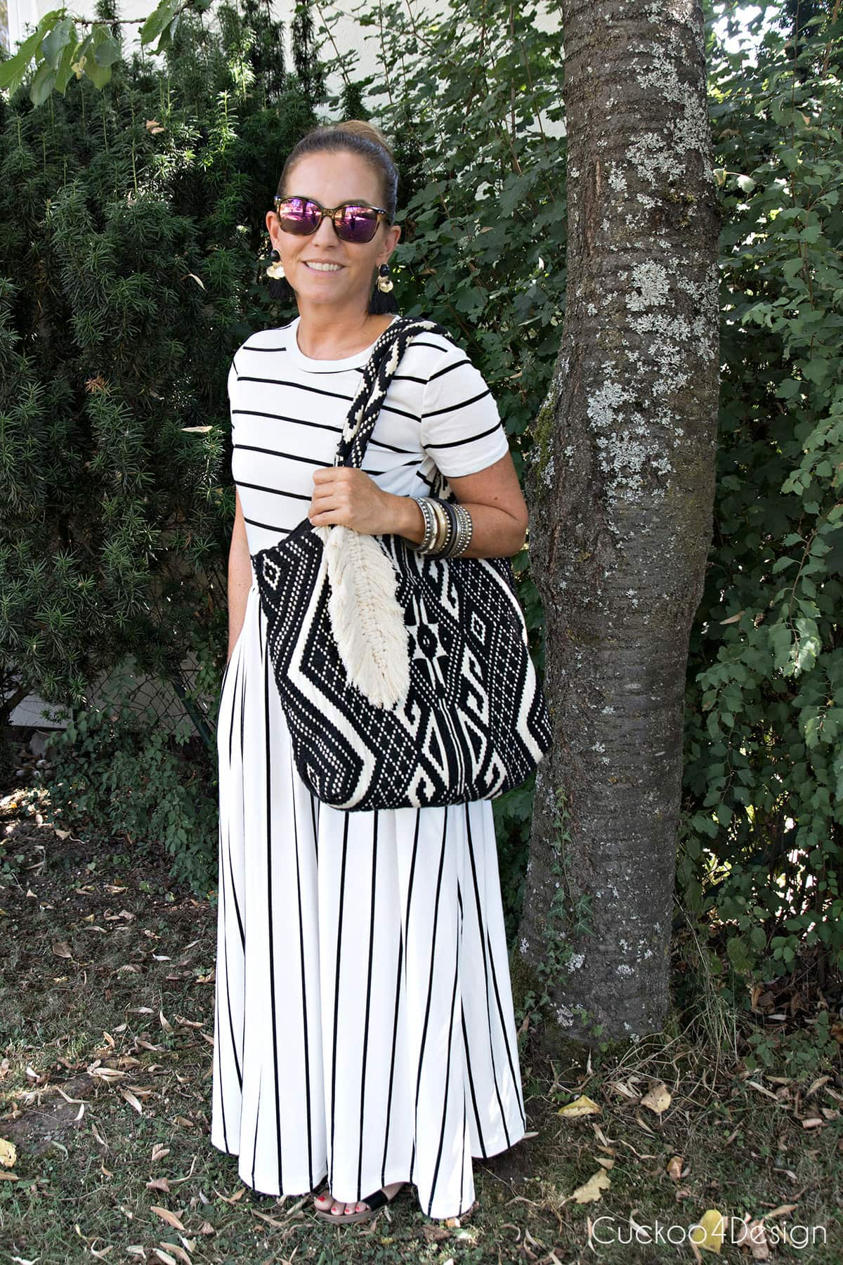 long black and white striped dress with shoulder bag and purse charms