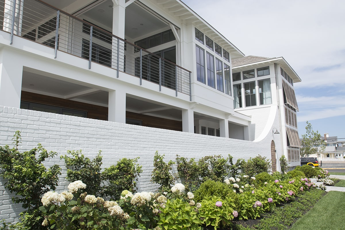large modern beach front home in Stone Harbor with Bahama shutters