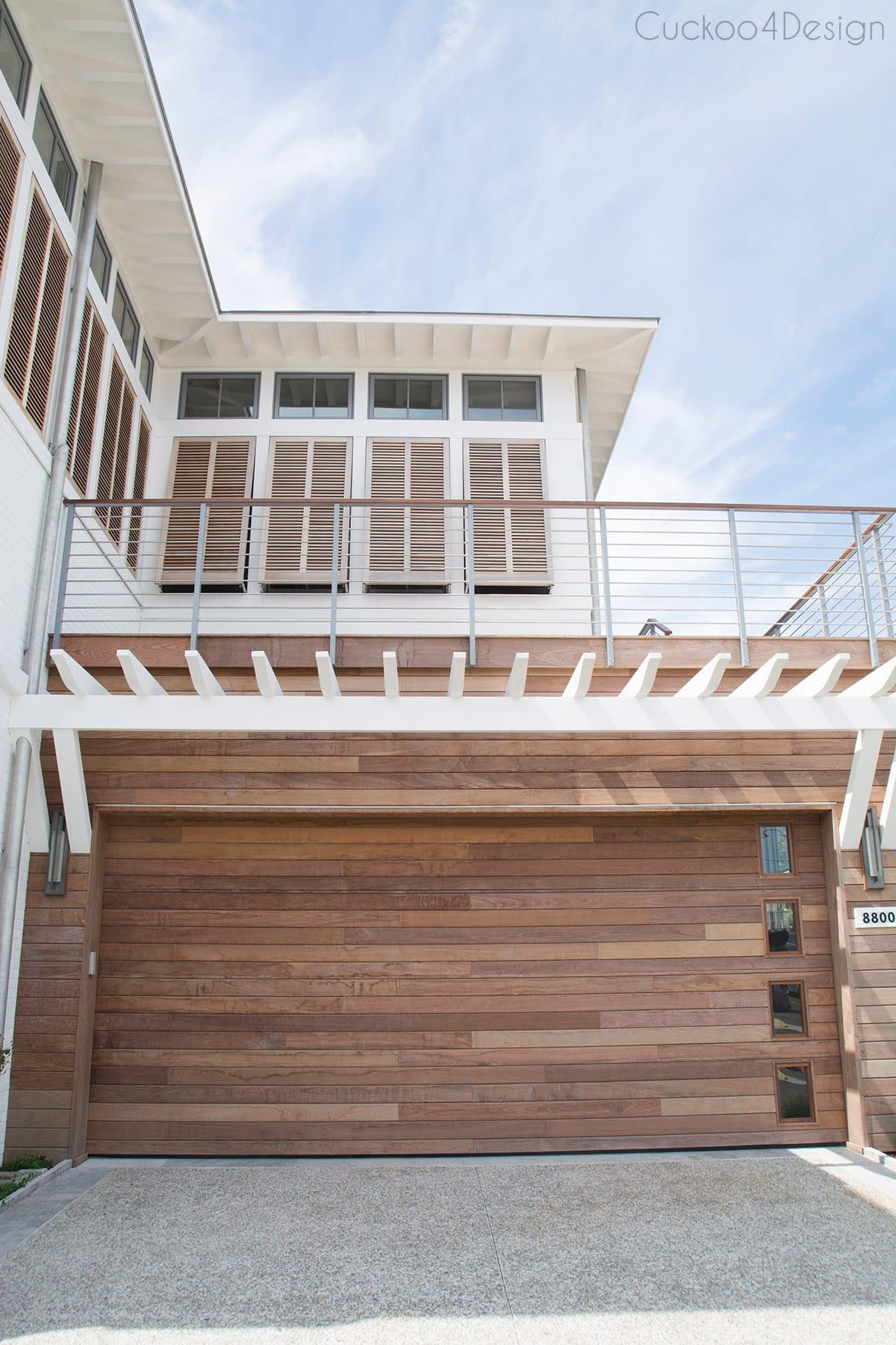wooden Bahama shutters with modern wooden garage door