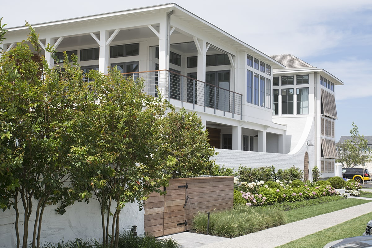 modern Stone Harbor beach home on 88th Street with Bahama shutters
