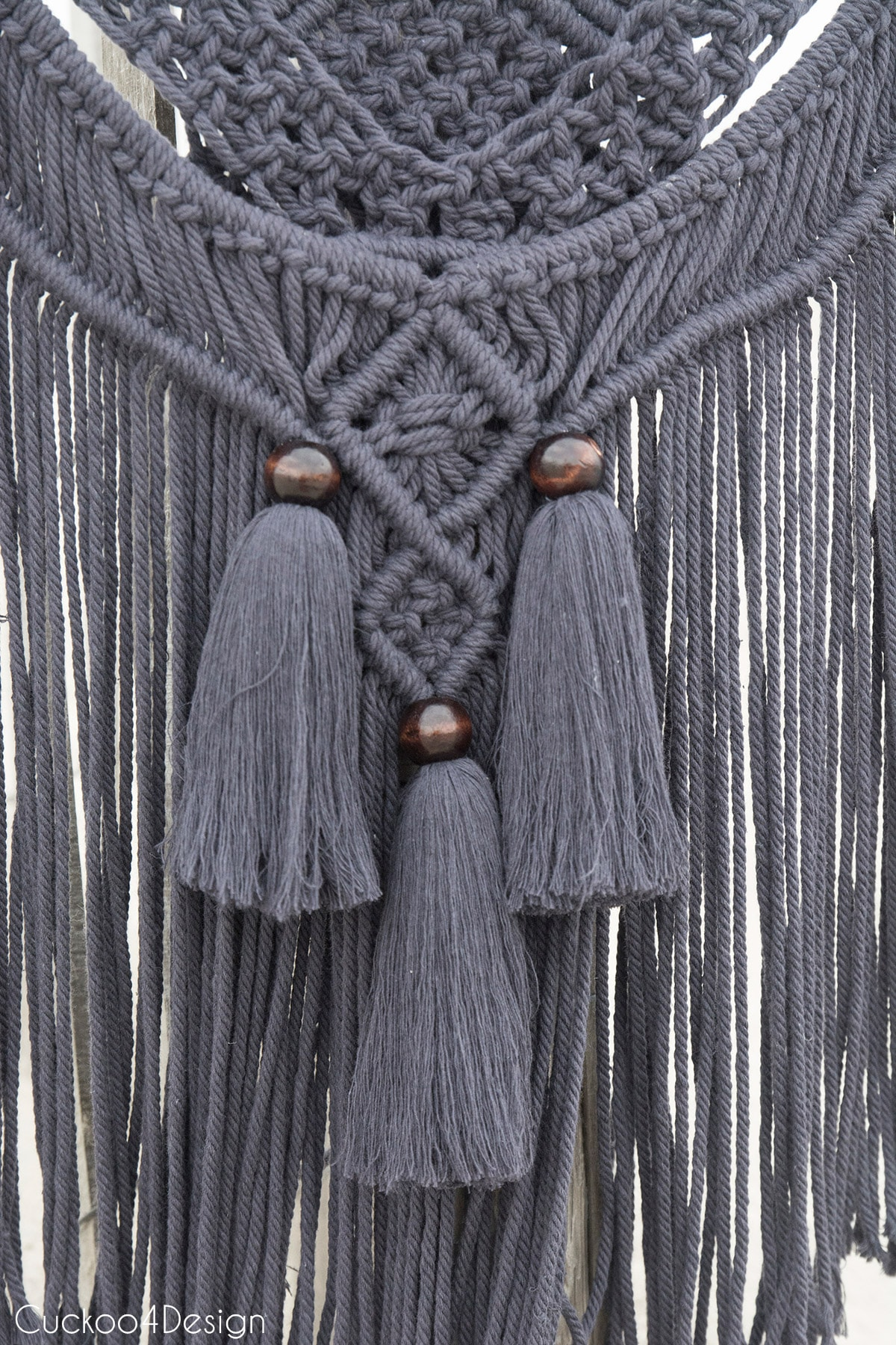 dark gray macrame wallhanging with tassels