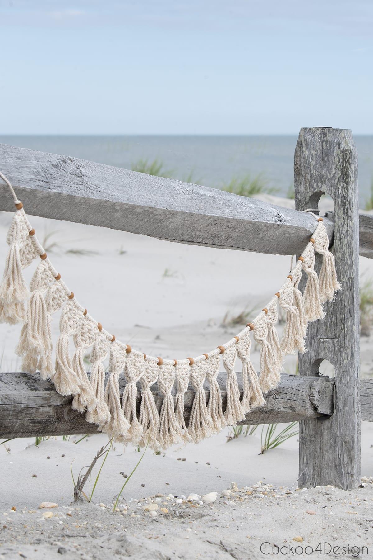 DIY macrame garland hanging on the beach