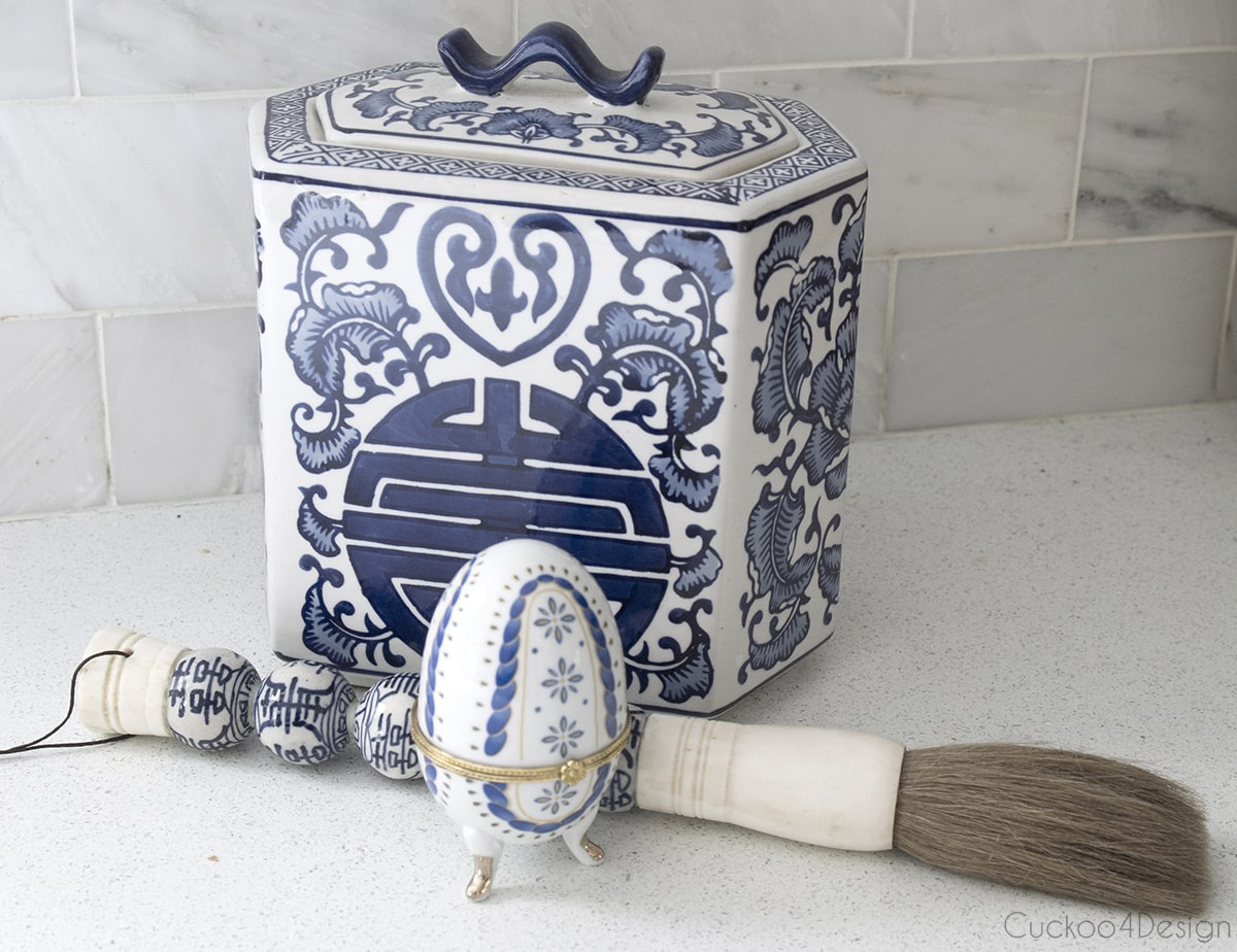 blue, white and gold porcelain egg on feet