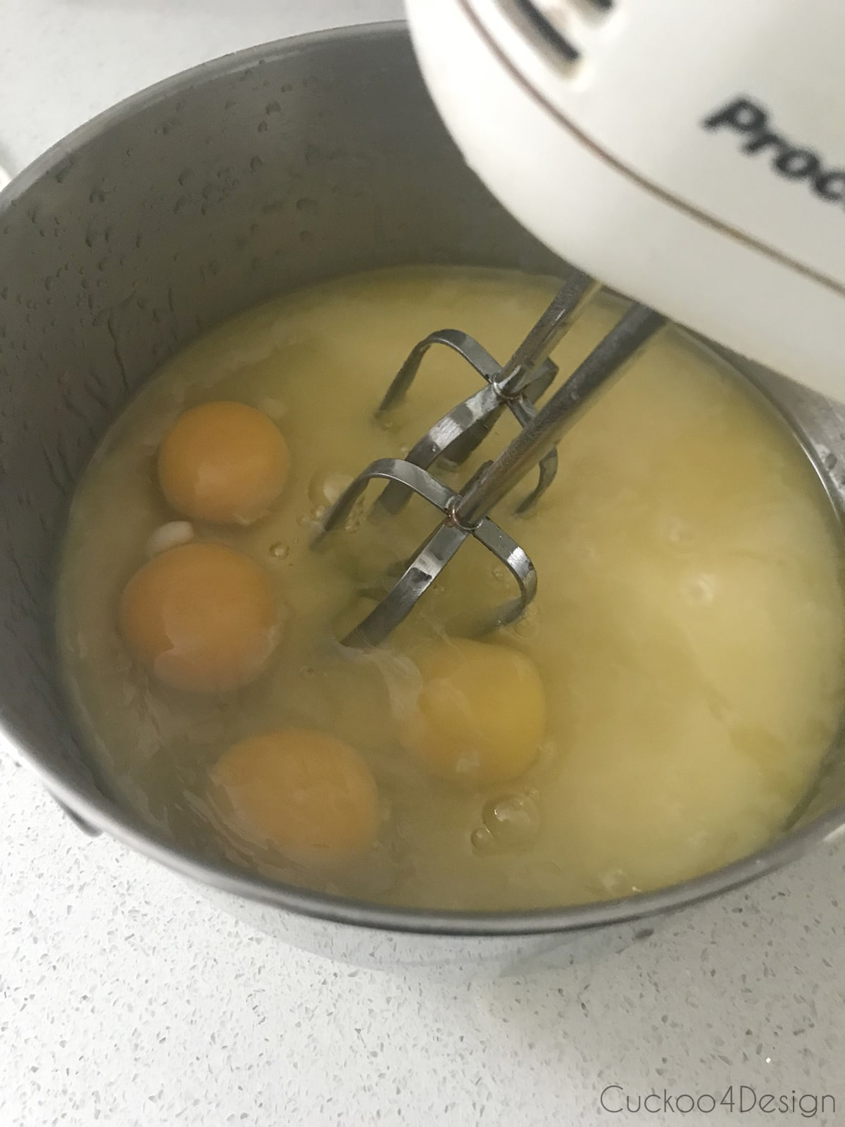 mixing eggs, sugar and butter for German layered cake