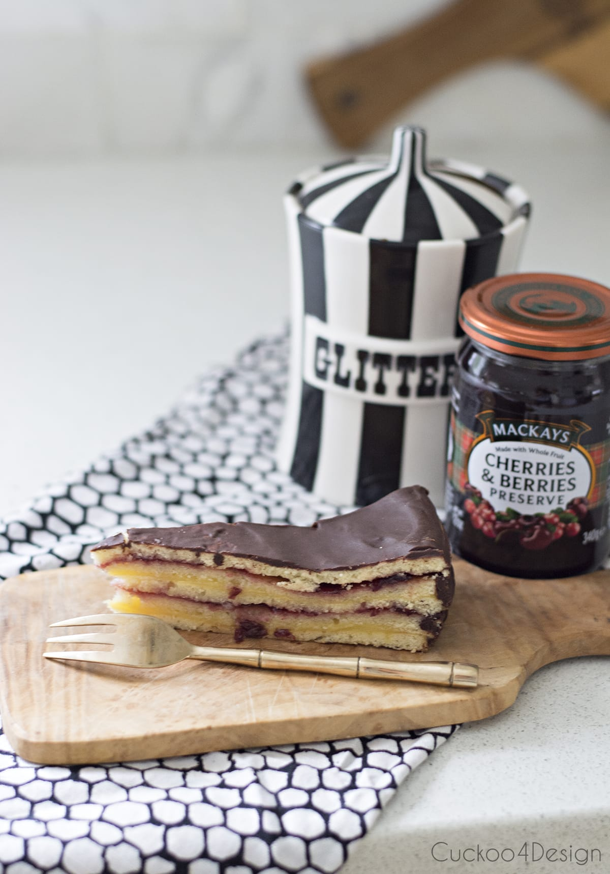 German layered cake with chocolate glaze, vanilla pudding and jelly