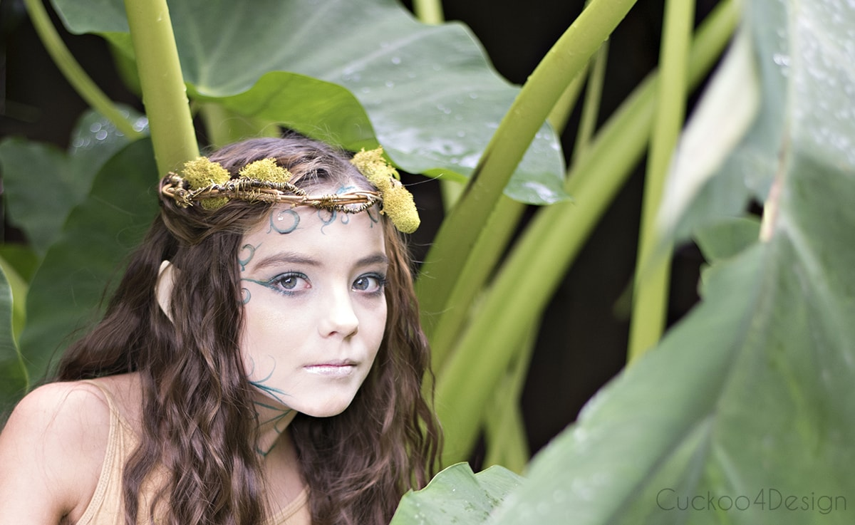 little forest elf with big leaves